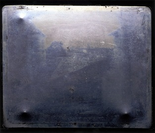 Joseph Nicéphore Niépce, ca. 1826. View from the Window at Le Gras [Direct positive image on bitumen coated pewter plate 19.685 x 16.51 cm]. Austin TX, USA: Gernsheim Collection, Harry Ransom Center.